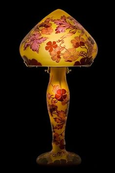 [Table Lamp with dragonfly on swamp drawing in art nouveau style, Emile Galle reproduction] - gives a red glow to one corner of a seductive bedroom. Antique Lamps, Vintage Lamps, Vintage Lighting, Lampe Art Deco, Art Nouveau Furniture, Chandelier Lamp, Chandeliers, Stained Glass Lamps, Art Deco Lighting