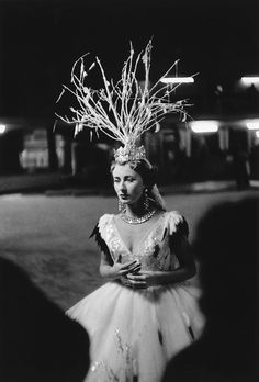 This image comes from Inge Morath's unpublished series of photographs from the Bal d'Hiver, held in Paris in 1955. Description from artspace.com. I searched for this on bing.com/images