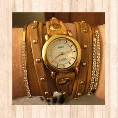 HOST PICKLa Mer wrap watch. Host Pick Best in jewelry party.       New conditioncamel & tan with gold studslooks great stacked with bracelets La Mer Accessories Watches