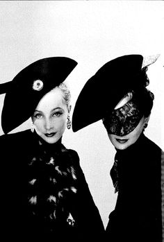 """Two tricorn hats for Schiaparellis 'crazy carnival' in 1938 captured by Erwin Blumenfeld.""  (Vogue)"