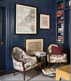 This is a great way to update old paneled walls. The deep navy blue color is masculine and cozy.
