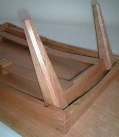 Note the clever sprung wood slat that holds the legs either opened out or folded closed