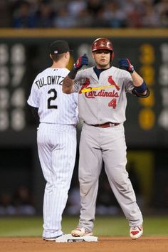 Yadier Molina sets club record for doubles by a catcher with his 41st to lead off the 4th inning. Cards v Rockies, 9/18/13.
