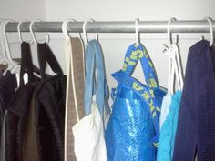 Hang bags up with shower curtain rings and keep random stuff in them. | 25 Brilliant Lifehacks For Your Tiny Closet