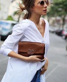 White shirt w denim, simple gold necklaces, tan bag / clutch