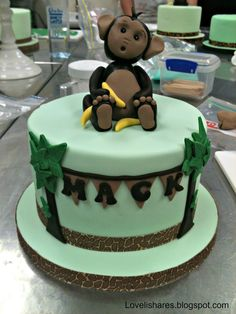 Monkey cake - topper is a little weird, but I like the palm trees and bunting