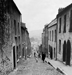 A photograph showing locals walking down a street in Cork, southwest Ireland, in the year It w. - Matt Loughrey / My Colorful Past Cork City Ireland, Dublin Ireland, Ireland Travel, Ireland Vacation, Ireland Homes, Irish American, Emerald Isle, Oui Oui, Northern Ireland