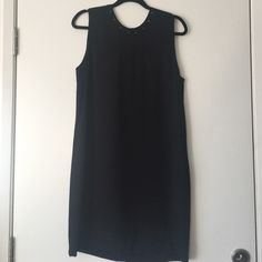 ZARA // timeless tank dress simple black tank dress with gold stud accents around the neck, and down the back of the dress. in great condition, only worn once! perfect for going to the office, then out! Zara Dresses Midi