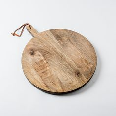 MARU Wooden Board   Beautiful and utilitarian, wood grained round board we use for displaying everything from artisanal cheese presentations to  freshly baked bread.