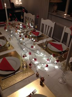 Christmas table decoration. Painted Branch with lights and Christmas decoration