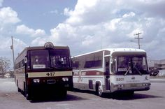 Photo taken on March 7, 1995.    Philippine Rabbit Nissan (fleet No 417) and UD Nissan CVK-944 (fleet No 2201) at the bus station at Tarlac Tarlac, Philippines.     http://choxeviet.com/Salon.aspx  http://choxeviet.com/nissan-fm41.aspx