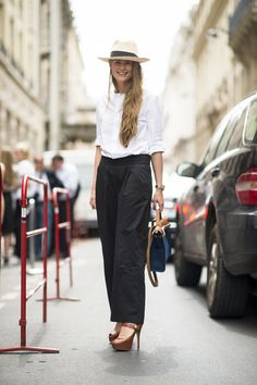 Wide-leg trousers are undeniably feminine when styled with a spiky-heeled shoe. Source: Le 21ème   Adam Katz Sinding