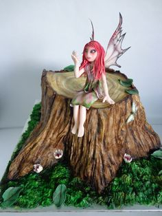 Woodland fairy cake - I done this cake my mams birthday, she loves fairies so thought this would be a nice idea as a cake. It's a chocolate cake with milk chocolate ganache covered in fondant, all hand painted. Fairy is gumpaste hand molded, with wafer paper wings, using edible marker and petal dust's. The only mold i used was for the little insect. Hope you like it, Thanks Zoe.