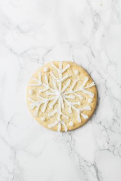 Snowflake sugar cookie perfect for the holiday season #sponsored: Photography: Ruth Eileen Photography - rutheileenphotography.com/   Read More on SMP: http://www.stylemepretty.com/2016/11/21//
