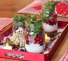 pine; greenery; holly; snow; artificial snow; mason jar; cranberries; tea lights; centerpiece; christmas; holiday