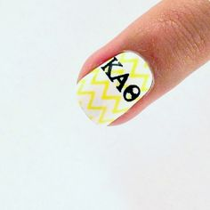 Kappa Alpha Theta real nail polish strips.  Easy to apply.  No heat required.  Remove with nail polish remover.  Love the look of the bold Greek letters on the yellow and white chevron.