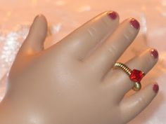 Here is a tutorial on how to make a tiny ring for your American Girl doll (or any other 18 inch doll)
