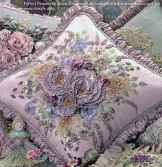 Beautiful work of ribbon embroidry on cushion