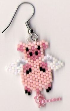 sweet-little-pair-of-pink-flying-pigs-dangle-earrings-1-and-1-2-inches-long $10.99