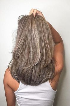 Chocolate Ash Blonde | It's time for a color change. Among the many hair color trends for 2018, hues with a little smoke are on the rise to the top. Traditional blondes and brunettes covered with a veil of gray are the ultimate cool-girl hair color now. These ash blonde hair colors are all over Instagram and Pinterest too. If that color sounds a little too out there for you, there are some subtle ash blonde trends that might surprise you too. Take a peek at a few of our favorites.