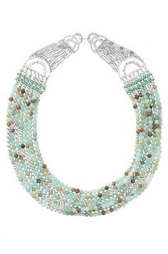Make a dramatic statement in our Cleopatra Stone Necklace. Made of  semi-precious stones in cool colors, only from Stella