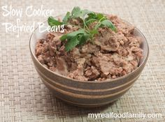 Healthy refried beans are super easy to make in the slow cooker!