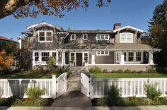 absolutely love how this looks...gate, fence, house colors, white trim everywhere