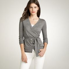 Part button-down, part wrap, this cardigan was inspired by a ballerina's warm-up sweater, and we think it's every bit as graceful. Designed to hug the body with a sash that you can adjust and tie however you like (we like it double-wrapped and tied in a side bow at the waist). Especially chic with ballets and cargos—and elegant with a pencil skirt and platforms. Pima cotton/wool in a 14-gauge knit. V-neck. Long sleeves. Hits below hip. Import. Hand wash. Catalog/jcrew.com only.