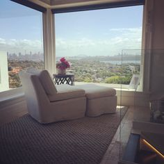 Perfect spot to #read... Oh and enjoy the view of the #sydneyharbourbridge in the background! We're at the #albertanddash showing at a #privateresidence in #vaucluse #sydney - #chair #lounge #daybed #window #view #rug #carpet #sydneyharbour #pink #white #beige #interior #interiordecor #interiordesign #interiorinspiration by modernhomemagazine http://ift.tt/1NRMbNv