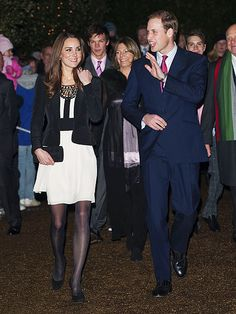 December 18, 2010 - HOLIDAY SPIRIT - A beaming William escorts Kate to their first public event since getting engaged a month earlier: the Christmas Spectacular, a fund-raiser for the Teenager Cancer Trust, in Norfolk, England. Despite the chilly weather, the Princess-to-be is greeted with applause for cutting a stylish figure in an Alice Temperley dress – and earns even higher marks from seven young cancer patients.