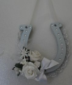A Lucky Horseshoe to the lovely couple This wooden horseshoe is painted in metallic silver The decorations include a lace edging with clear