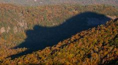 BEAR SHADOW, BLUE RIDGE MOUNTAINS, NORTH CAROLINA Cashiers is a town located in the center of the Blue Ridge Mountains in North Carolina. For 30 minutes everyday at 5:30 p.m. from late October through early November and again from mid-February to early March, you can see a shadow in the shape of a giant bear.