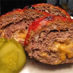 "Cheeseburger Meatloaf | ""This meatloaf is extremely juicy, and the potential variety of different flavors is as big as your imagination. I've done American cheese with ketchup and mustard on top and served with dill pickle chips. Another one might be Swiss cheese and mushroom topping."""