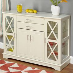 Add style and organization to your home with this charming white Kendall buffet. Beautifully constructed of wood with glass window accents, this buffet features adjustable glass shelves and ample storage space for a functional and attractive addition.