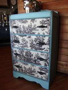 This Waterfall dresser was painted in a soft turquoise with the drawers decoupaged with black and white toile.