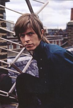 David Robert Jones (1947-2016), known as David Bowie, photographed on a Marylebone rooftop in Manchester Street W1, 1967