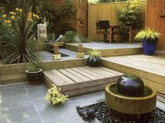 Small Decked Garden Ideas small yard idearaised hardwood deck entertaining area by modular garden Small Yard Design Ideas Deck Designgarden