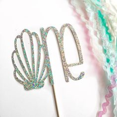 Add a little sparkle to the top of your cake with thisglitter cake topper! Product details: Made with your choice of one-sided glitter card stock **topper sho