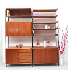 http://cgi.ebay.fr/Elegantes-50er-Regalsystem-modular-in-Teak-/200643225980?pt=Design_Stil=item2eb744a97c