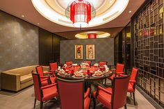 One of the semi private dinning rooms at the House of Fame Chinese restaurant of the Crowne Plaza Shanghai Anting hotel. The private dinning room feature traditional yet modern furniture & interior design with Red furniture and lights.