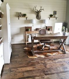 Shiplap is a popular wall treatment for a reason: it's great for fixing damaged walls, it adds character, and it's an expensive and easy DIY. See how Jill transformed her office into a beautiful rustic space.  Minus the rug~