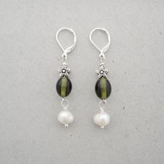 Sophisticated Green and Pearl Earrings    Wear with a gown or wear with a pair of jeans. These earrings will never go out of fashion.