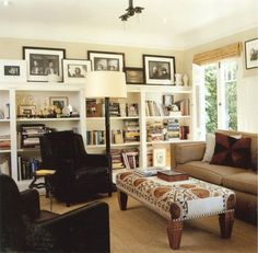 I love the bookshelves and frames. The  coffee table/ottoman? is also awesome