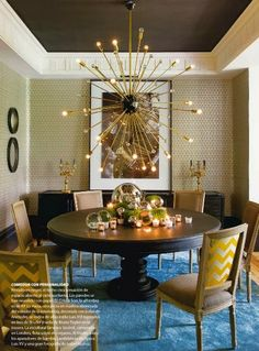 Sputnik Chandelier Over Round Breakfast Dining Table In A Beige Room With Cigar Brown Painted Ceiling And Blue Rug
