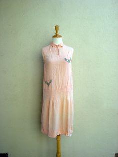 1920s era peachy pink dress.