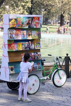 Books On Bikes. That little girl reminds me of Cheska, how she likes read! :D