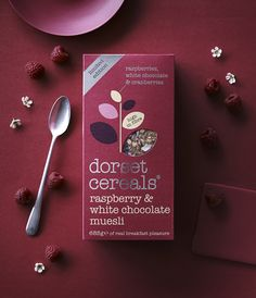 zingy raspberries and creamy white chocolate shavings, blended with cranberries, raisins and multigrain flakes Cereal Packaging, Biscuits Packaging, Fruit Packaging, Food Packaging Design, Chocolate Packaging, Packaging Design Inspiration, Dorset Cereals, Vegetable Packaging, White Chocolate Raspberry