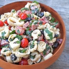 Tortellini Salad –   A meal in one salad, with cheese tortellini, salami, fresh basil, tomatoes, olives and spinach.