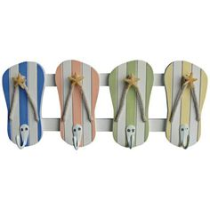 A fun pastel color hand-painted flip flop wooden wall hook with five chrome hooks.