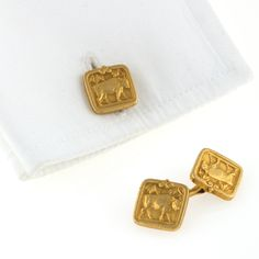 Tiffany & Co. Antique Double-Sided Cufflinks A pair of American Antique 18 karat gold cufflinks by Tiffany & Co.. The cufflinks are framed squares with the profile of a bull portrayed. Double sided. Signed with the 'M' mark for Tiffany designer John Moore